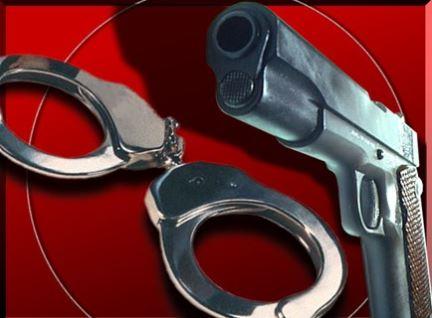 Handcuffs, gun, child 2-12-19_1550006344925.JPG.jpg