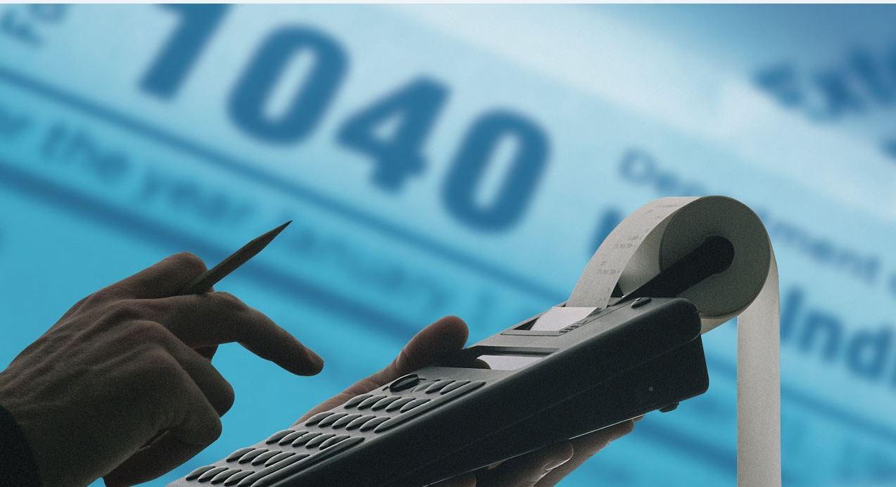 IRS art calculator on blue 1040_1549753421352.JPG.jpg