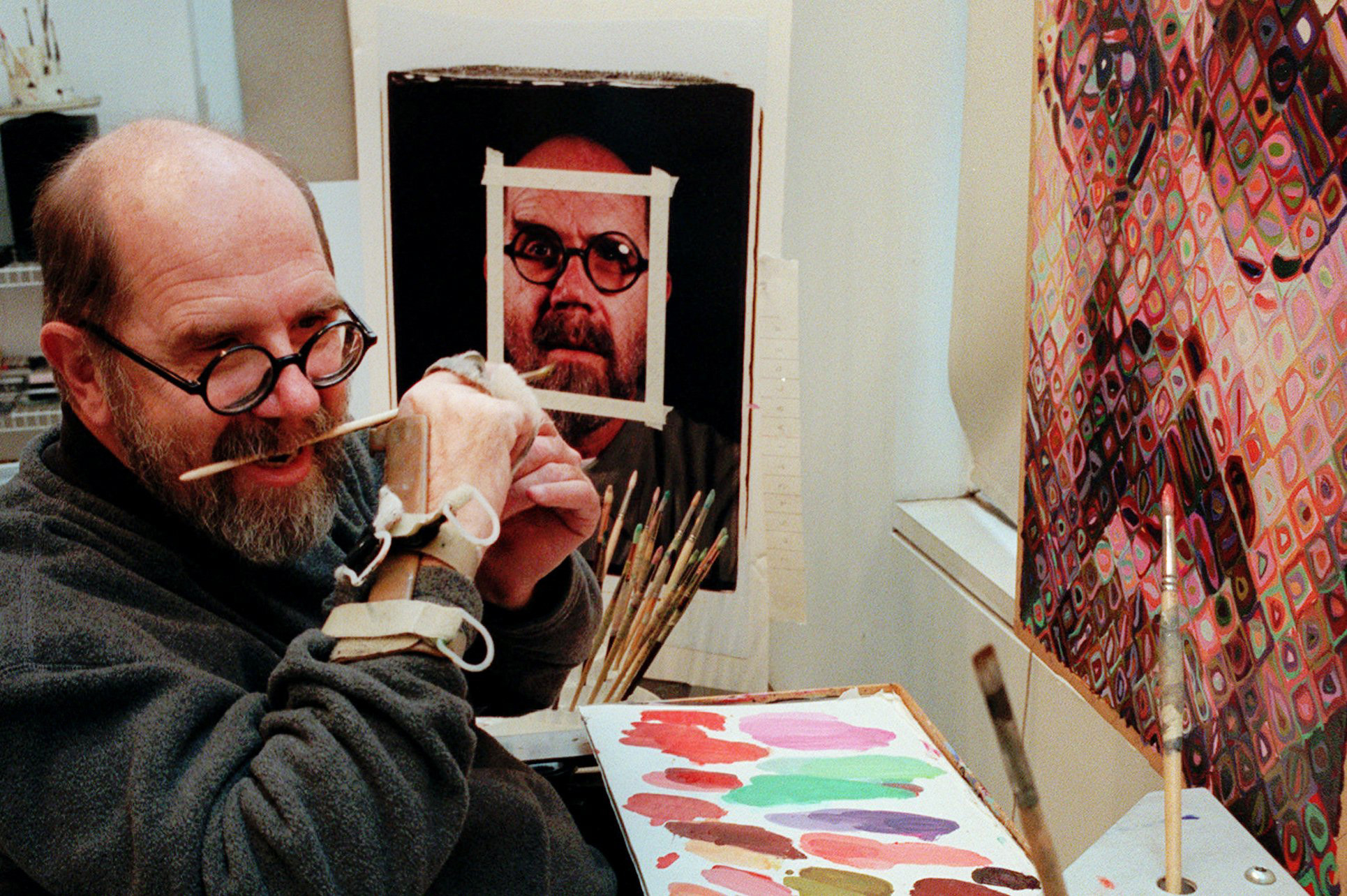 Chuck Close, CLOSE GRIPS BRUSH IN TEETH WITH HAND BRACE