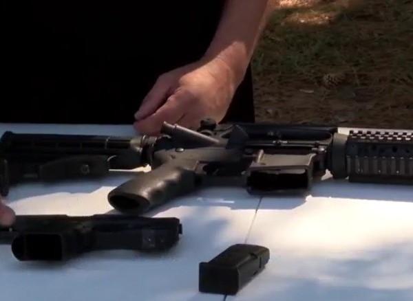 A firearms expert points to prop guns used on movie sets